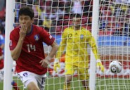 South Korea's Lee Jung-soo celebrates scoring a goal against Greece during their 2010 World Cup Group B soccer match at Nelson Mandela Bay stadium